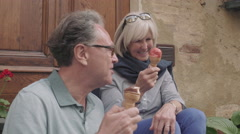 Senior couple enjoying icecream on holiday Stock Footage