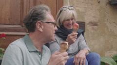 Senior couple enjoying icecream on holiday - stock footage