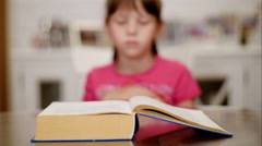Little girl reading a book-timelapse Stock Footage
