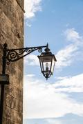 Vintage street lamp in wrought iron. Stock Photos
