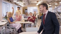 4K Portrait smiling business manager in office with staff clapping in background Stock Footage