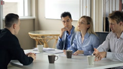 Office workers meet during coffee break to discuss working details Stock Footage
