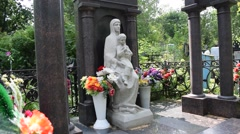 Woman with a child tombstone (approximate) - stock footage