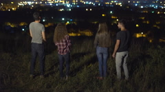 The people stand on the background of the night city. Wide angle. Real time Stock Footage