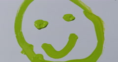 Child Painting Smiley Face on White Paper Having Fun 422 10bit, 4K Stock Footage