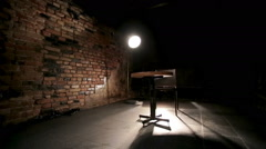 A young soldier in thought. A scene in a dark room with one light bulb that Stock Footage