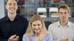 Three persons happily clap their hands to express delight Stock Footage