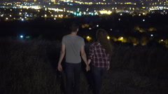 The couple stand on the background of the city. Night evening view. Wide angle.  Stock Footage