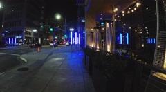 Men Walk Past Upscale Restaurant At Night- Long Beach CA Stock Footage
