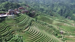 AERIAL FLY BY TILT SHOT OF CABLE CAR GOING UP LONGJI RICE TERRACE GUILIN CHINA Stock Footage