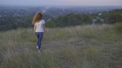 The woman stand on the background of the city. Wide angle. Real time capture Stock Footage