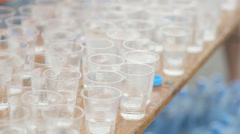 Water in plastic glass during a sport event Stock Footage