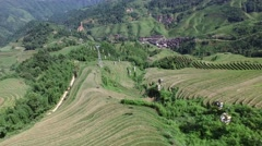 AERIAL CLOSE UP OF CABLE CAR OVER JINKENG RICE TERRACE FIELDS (LONGJI) CHINA Stock Footage
