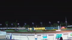 Horses At Race Track Crossing The Finish Line Wide- Los Alamitos CA Stock Footage