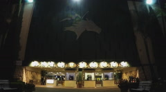 People Entering And Exiting Los Alamitos Horse Racing Track At Night Stock Footage