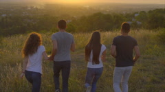 The people jump on the background of sunset. Wide angle. Slow motion Stock Footage