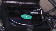 Young girl on picnic in the meadow listening to the record on vintage gramophone Stock Footage