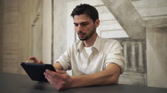 Businessman holding gadget and use internet in the office Stock Footage