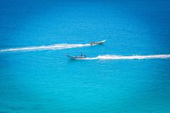 The boat in the azure ocean Stock Photos