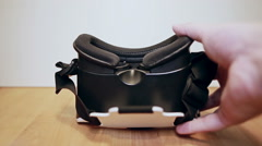 Mans hands put virtual reality glasses, VR on the table Stock Footage