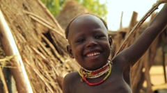 Happy Child Smiling in Village Within the Omo Valley - Medium Close Up Stock Footage