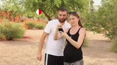 Two Millennials Play Pokemon Go Outside Stock Footage