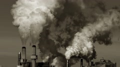 Factory Smoke Stacks Billow Thick Smoke or Steam Emissions Into Sky Stock Footage