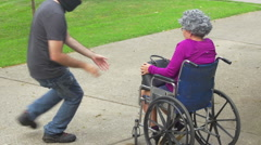 man stealing purse from old woman - stock footage