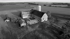 Rustic abandoned farm, scenic black and white aerial view Stock Footage