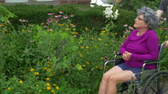 Pushing old woman in wheelchair wheel chair 2 Stock Footage