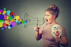 Woman screaming in megaphone. Propaganda social media communication concept Stock Photos