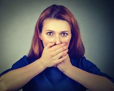 Concerned scared woman covering her mouth with hands Stock Photos