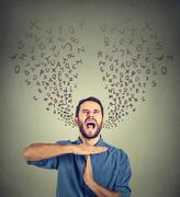 Young man showing time out hand gesture, frustrated screaming to stop - stock photo