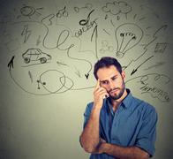 young man planning future life, idea light bulb above head - stock photo