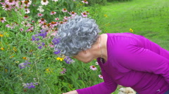 Senior citizen looking at garden outside Stock Footage