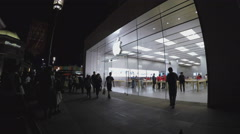 People Inside And Outside Of Apple Products Store At Night - Glendale CA Stock Footage