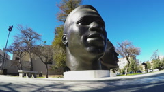 Low Angle Mack And Jackie Robinson Head Sculptures Memorial - Pasadena CA Stock Footage
