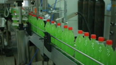 Bottling of lemonade in plastic bottles. Lemonade bottle conveyor industry Stock Footage