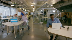 4K Time lapse of busy creative business team working hard in trendy office Stock Footage
