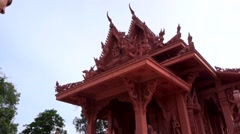 Young male traveler taking photo of Asian buddhist temple. Stock Footage