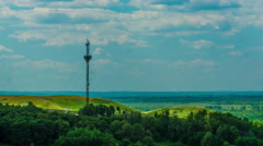 Telecommunications tower communications on a background of sky clouds Stock Footage