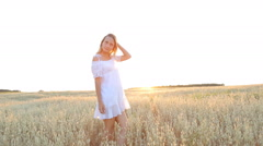Beauty Smiling Girl on the golden Field. Laughing And Happy young model woman Stock Footage