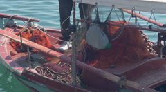 Fisherman prepares drift net in the boat by Sheyno, holding hands close up. Stock Footage