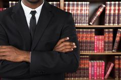 Close-up Of A Male Lawyer With Arms Crossed In Office Stock Photos