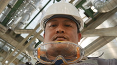 Man with safety helmet in industrial plant Stock Footage