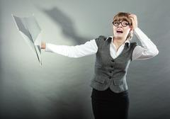 Fly fear. Woman holding airplane in hand. Stock Photos