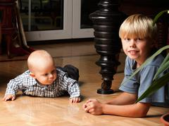 Little boy playing with a brother Stock Photos