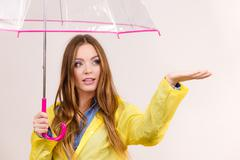Woman in rainproof coat with umbrella. Forecasting Stock Photos