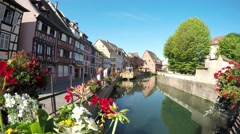Colmar, Alsace, France - Canal boat at Little Venice. Half-timbered houses. Stock Footage