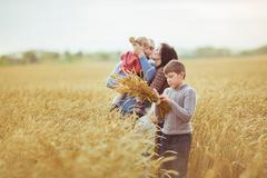 Happy family on a agricultural field in autumn Stock Photos